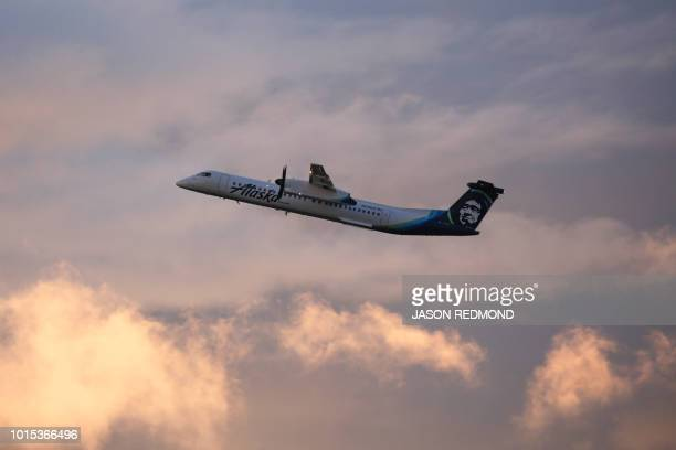 An Alaska Airlines Bombardier Dash 8 Q400 operated by Horizon Air takes off from at SeattleTacoma International Airport International Airport one day...