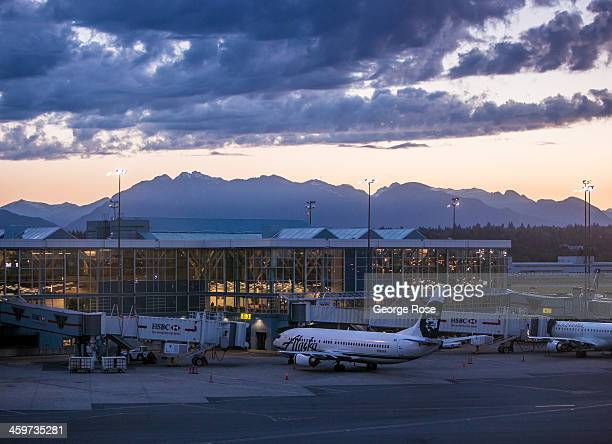 An Alaska Airlines jet is parked at a Vancouver International Airport terminal just before sunrise on June 3, 2013 in Vancouver, British Columbia,...