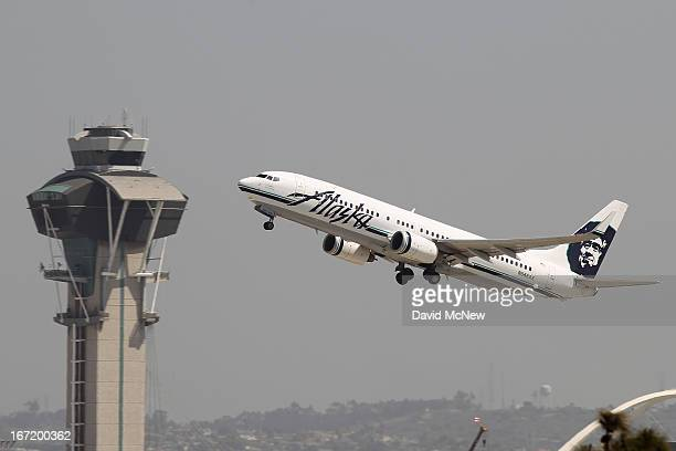An Alaska Airlines jet passes the air traffic control tower at Los Angles International Airport during takeoff on April 22 2013 in Los Angeles...