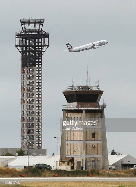 An Alaska Airlines plane takes off past a halfcompleted 236foot FAA control tower at Oakland International Airport on July 26 2011 in Oakland...