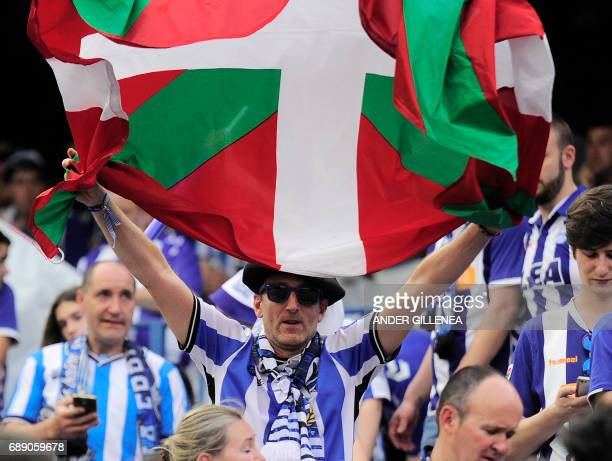 An Alaves' supporter displays a Basque flag before the Spanish Copa del Rey final football match FC Barcelona vs Deportivo Alaves at the Vicente...