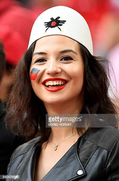 An Albania supporter cheers prior to the Euro 2016 group A football match between France and Albania at the Velodrome stadium in Marseille on June 15...