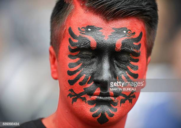 TOPSHOT An Albania supporter closes his eyes as he waits for the start of the Euro 2016 group A football match between Albania and Switzerland at the...