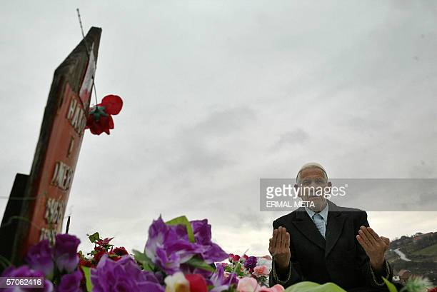 An Albanian man Imer Imeri pray, 12 March 2006 in the village of Racak, 30 kilometres in the south of Kosovo's capital Pristina, in front of the...
