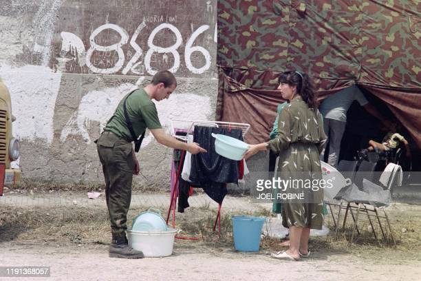 An Albanian refugee couple rest at the Restinco military camp on July 14 1990 in Brindisi Italy After several days of negociations with France West...