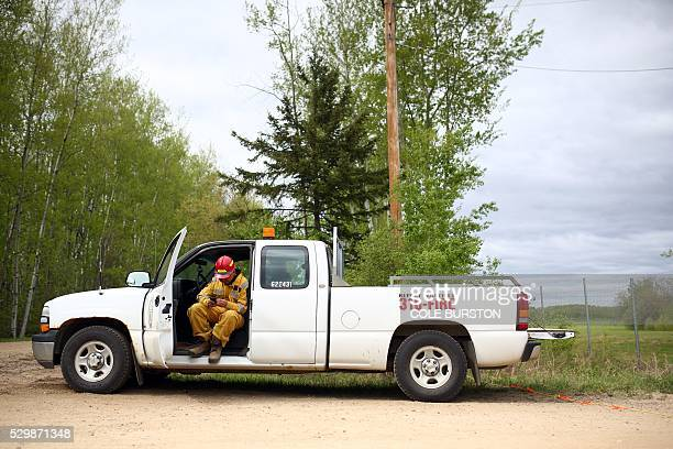 An Alberta Forestry ranger sits in a truck outside the Lac la Biche Airtanker base in Lac la Biche Alberta on May 9 amid extensive wildfires in the...