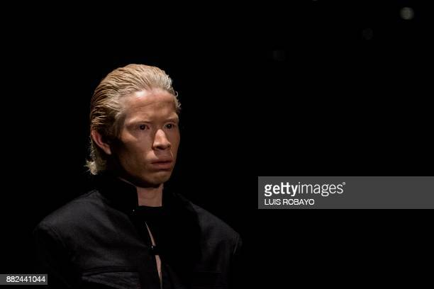 An albino man models a creation by Colombian designer Guio Di Colombia during the Walkway Inclusion fashion show in Cali Colombia on November 29 2017...