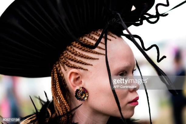 TOPSHOT An albino model presents a creation of a local designer during a fashion show at the 2017 edition of the Durban July horse race in Durban on...