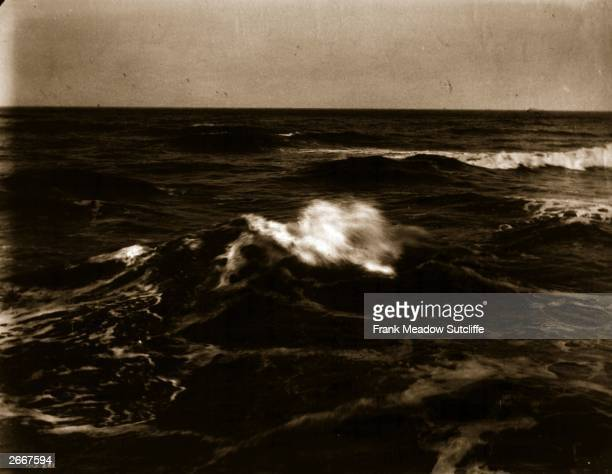 An albumen print of a wave breaking in an atmospheric seascape from the series 'Views Around Whitby And Eskdale North Yorkshire'