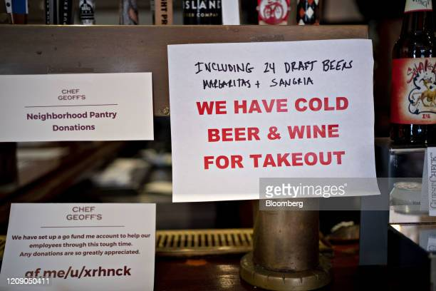 An alcohol takeout sign hangs on the bar at Chef Geoff's restaurant in Washington DC US on Thursday March 26 2020 As the wheels of government turn...