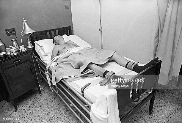An alcoholic man strapped into his bed in the delirium treatment ward at a New Mexico hospital circa 1972