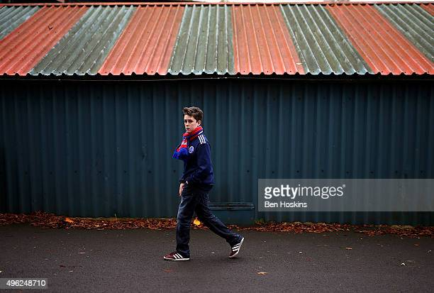 An Aldershot fan walks to the ground ahead of The Emirates FA Cup First Round match between Aldershot Town and Bradford City on November 8 2015 in...