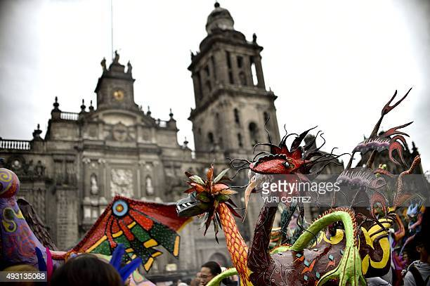 An 'Alebrije' is pictured in front of El Zocalo square's Cathedral during Ninth Monumental 'Alebrijes' Parade and contest on October 17 2015 in...