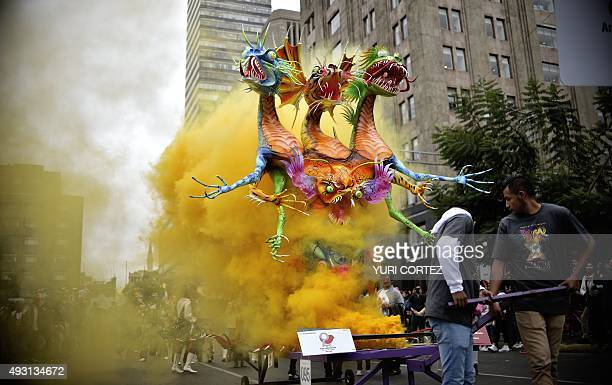 An Alebrije is pictured on the street during Ninth Monumental Alebrijes Parade and contest on October 17 2015 in Mexico City Some 221 Alebrijes...