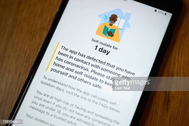 An alert on the official NHS Covid-19 Test and Trace app informing the user to quarantine for one day is seen on January 18, 2021 in London, United...