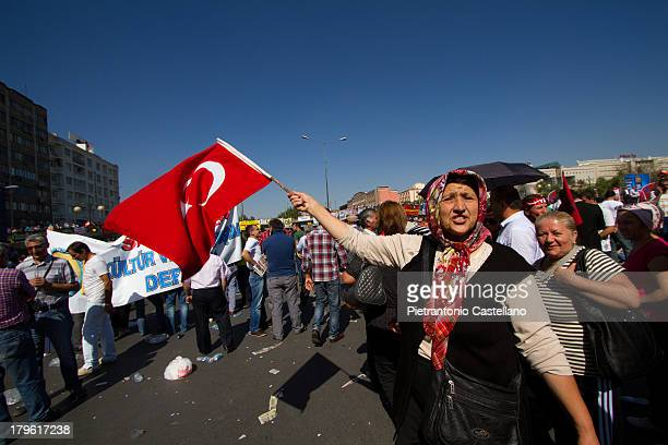 CONTENT] An Alevi protester waves a Turkish flag in Ankara's Sihhiye square