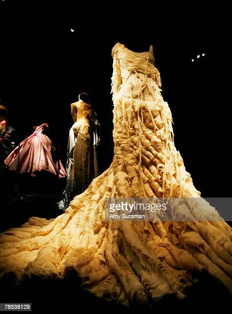 "An Alexander McQueen ""Oyster"" dress is displayed at the ""Blog.mode: addressing fashion"" exhibit at the Metropolitan Museum of Art's Costume Institute..."