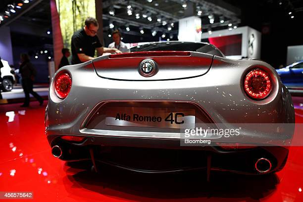 An Alfa Romeo 4C automobile produced by Fiat Chrysler Automobiles NV sits on display at the Paris Motor Show in Paris France on Thursday Oct 2 2014...