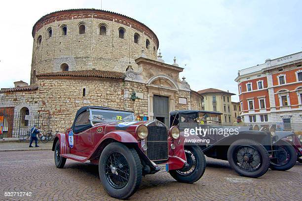 An ALFA ROMEO 6C 1750 GT CABRIOLET and a LANCIA LAMBDA TIPO 221 SPIDER CASARO waits for the start of the Mille Miglia on May 19 2016 in Brescia Italy