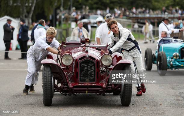 An Alfa Romeo 8C 2300 Monza is pushed back to the paddock during the Goodwood Revival at the Goodwood Motor Circuit in Chichester