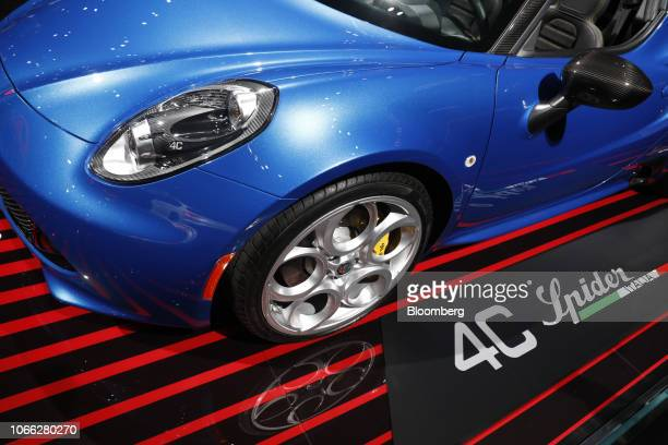 An Alfa Romeo Automobiles SpA 4C Spider convertible luxury vehicle produced by Fiat Chrysler Automobiles NV sits on display during AutoMobility LA...