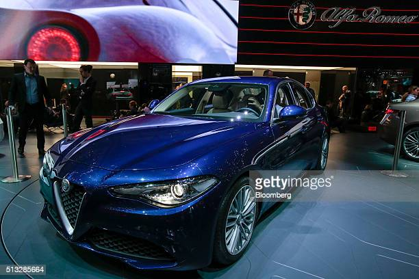 An Alfa Romeo Giulia sedan automobile produced by Fiat SpA sits on display on the second day of the 86th Geneva International Motor Show in Geneva...