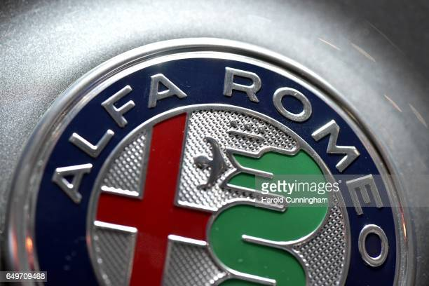 An Alfa Romeo logo detail is seen during the 87th Geneva International Motor Show on March 8 2017 in Geneva Switzerland The International Motor Show...