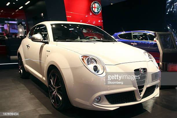 An Alfa Romeo MiTo automobile produced by Fiat SpA sits on display on the on the first day of the Paris Motor Show in Paris France on Thursday Sept...