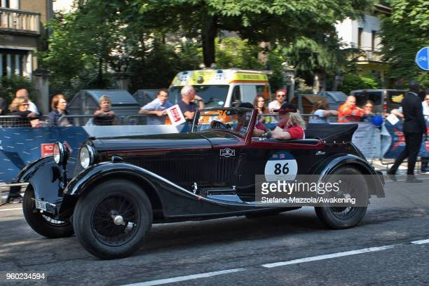 An Alfa Romeo TIPO 6C 1750 GRAN SPORT CASTAGNA passes through the city center of Brescia during the last day of the 1000 Miles Historic Road Race...