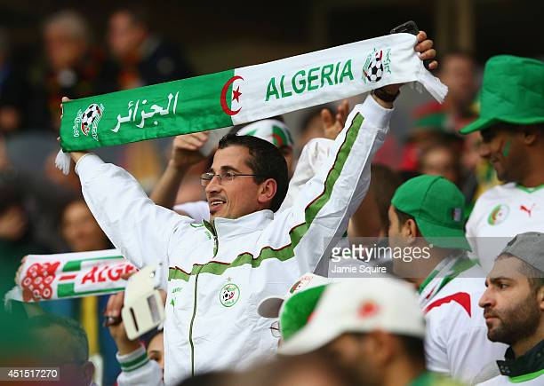 An Algeria fan enjoys the atmosphere prior to the 2014 FIFA World Cup Brazil Round of 16 match between Germany and Algeria at Estadio BeiraRio on...