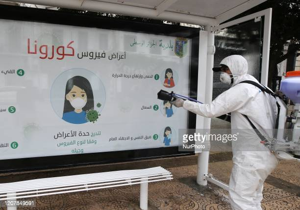 An Algerian health worker disinfects a bus stop in Algiers, Algeria, 20 March 2020. Friday prayers have been suspended in Algeria amid the spread of...