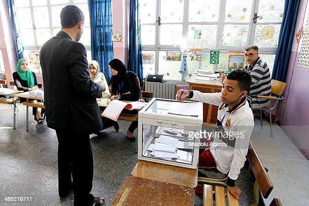 An Algerian man casts his ballot for Algeria's presidential election at a polling station in Algiers Algeria on April 17 2014 Voting started Thursday...