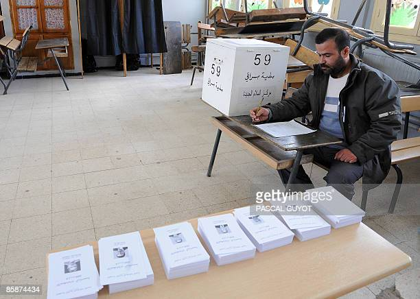 An Algerian man waits on April 9 2009 for voters to cast ballots in a voting office during the presidential elections in algiers Incumbent President...
