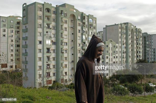 An Algerian man walks in one of the many new residential districts outside the capital Algiers on January 23 2017 Experts say urban violence is on...