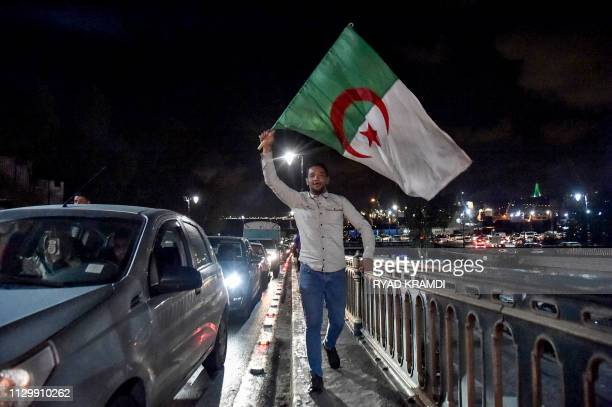An Algerian marches with a national flag during a demonstration in the centre of the capital Algiers on March 11 after President Abdelaziz Bouteflika...