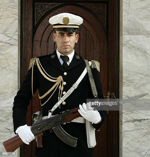 An Algerian military guard stands at attention outside the Algerian presidential palace as US Secretary of Defense Donald Rumsfeld meets with...