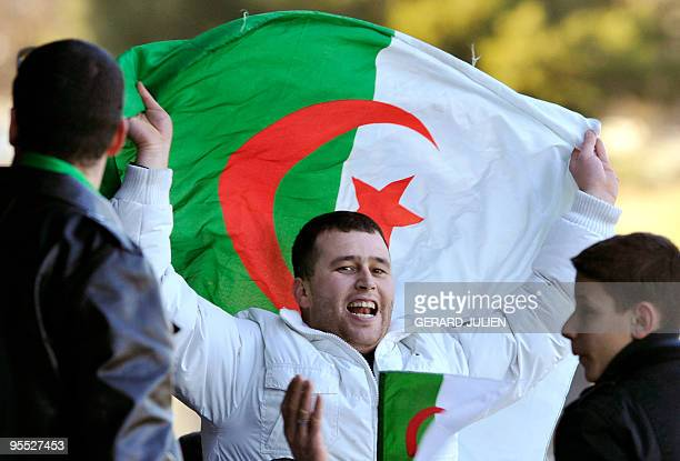 An Algerian national football team's fan supports the team during a training session ahead of the 2010 African Nations Cup on January 2 2010 in...