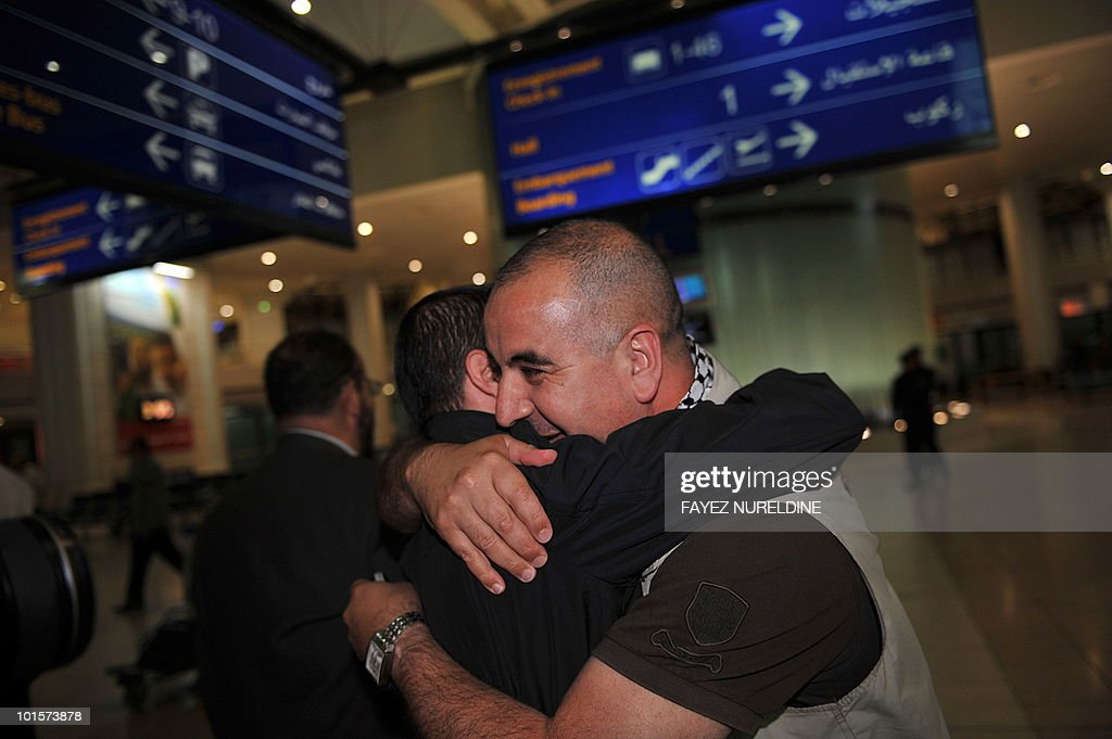 An Algerian pro-Palestinian activist, who was detained aboard the Gaza-bound aid flotilla raided by Israel on May 31, 2010, receives a hug from a relative as he arrives at Algiers International airport early on June 3, 2010. Thirty two Algerian activists deported from Israel arrived in Algiers following their release from arrest by Israel after its deadly raid on an aid flotilla headed for Gaza.