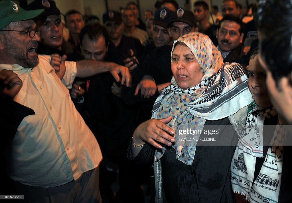 An Algerian pro-Palestinian activist (C), who was detained aboard the Gaza-bound aid flotilla raided by Israel on May 31, 2010, is greeted by supporters at Algiers International airport early on June 3, 2010. Thirty two Algerian activists deported from Israel arrived in Algiers following their release from arrest by Israel after its deadly raid on an aid flotilla headed for Gaza.