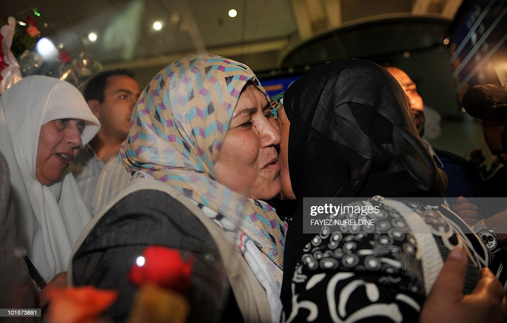 An Algerian pro-Palestinian activist (L), who was detained aboard the Gaza-bound aid flotilla raided by Israel on May 31, 2010, receives a hug and kiss from a relative as she arrives at Algiers International airport early on June 3, 2010. Thirty two Algerian activists deported from Israel arrived in Algiers following their release from arrest by Israel after its deadly raid on an aid flotilla headed for Gaza.