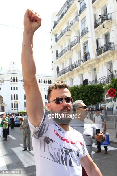 An Algerian protester shouts antisystem slogans during the weekly Friday demonstration in the capital Algiers on June 21 2019 Hundreds of Algerian...