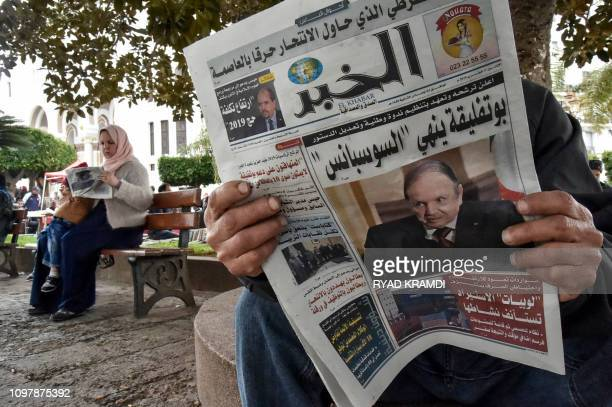 An Algerian reads a newspaper in the capital Algiers on February 11 writing about the upcoming presidential election scheduled for April 18 Abdelaziz...