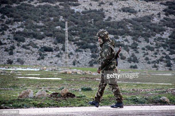 An Algerian soldier takes part in a rescue operation after an C130 Hercules aircraft crashed into Mount Fertas in the Oum El Bouaghi region about 500...