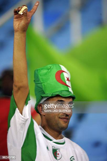 An Algerian supporter cheers up ahead of their semi final match of the African Cup of Nations CAN2010 at the Ombaka stadium in Benguela Angola on...