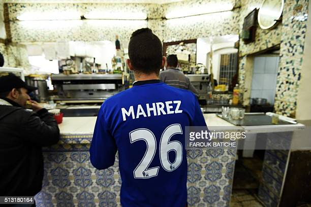 An Algerian supporter wears a shirt of English football club Leicester City's midfielder Riyad Mahrez at a cafe on February 13 2016 in the old part...