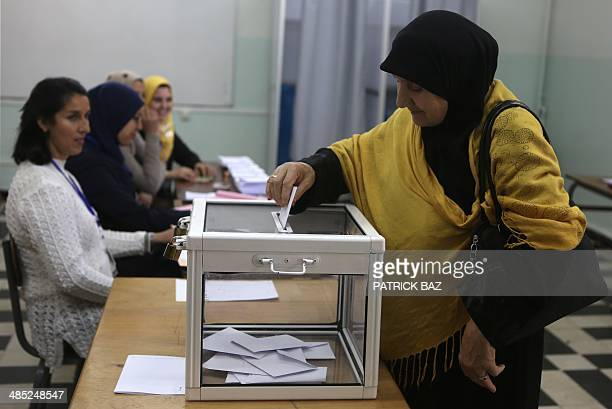 An Algerian woman casts her vote in the presidential elections at a polling station in Algiers on April 17 2014 Algerians are voting in a...