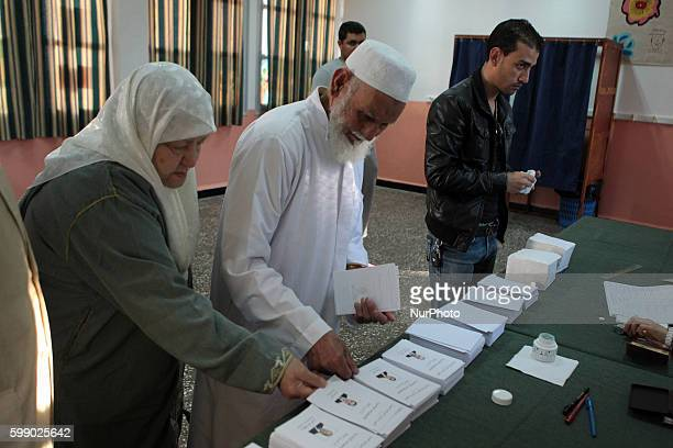 An Algerian woman do his duty casts her ballot at a polling centre in Algeirs on April 17 2014 in Algeria's Abdelaziz Bouteflika who is running for a...