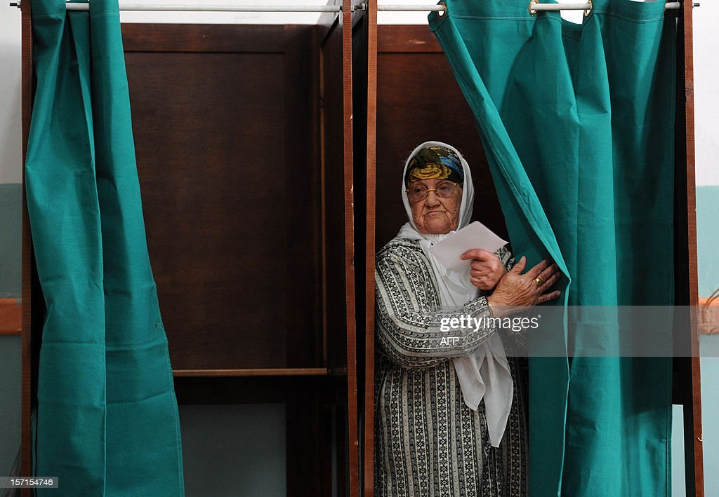 An Algerian woman leaves a voting booth before casting her vote at a polling station in Algiers, during local elections on November 29, 2012. Algeria's ruling party is eyeing a landslide victory in local elections, with numerous opposition groups warning of fraud in a poll that could struggle to mobilise a disaffected electorate.