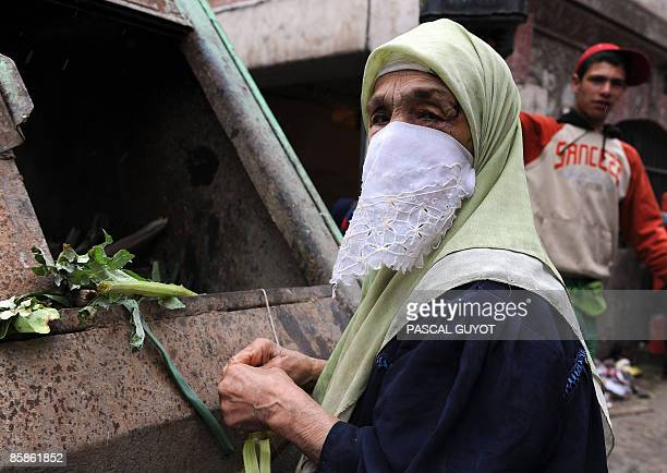 An Algerian woman looking for food in a market garbage on April 8 in Algiers on the eve of the presidential election The African Union will send a...