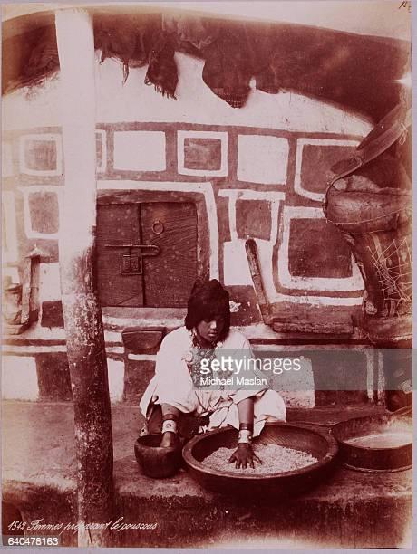 An Algerian woman prepares grain, ca. 1890s.
